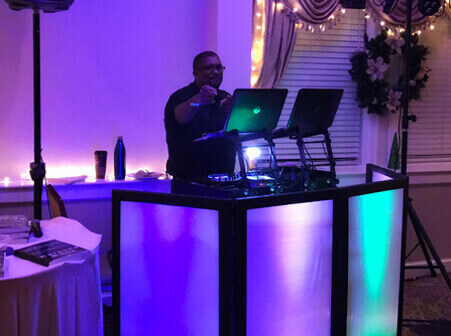 DJ at stand with up lighting