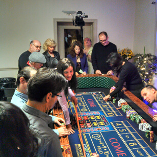 people gathered around a craps table