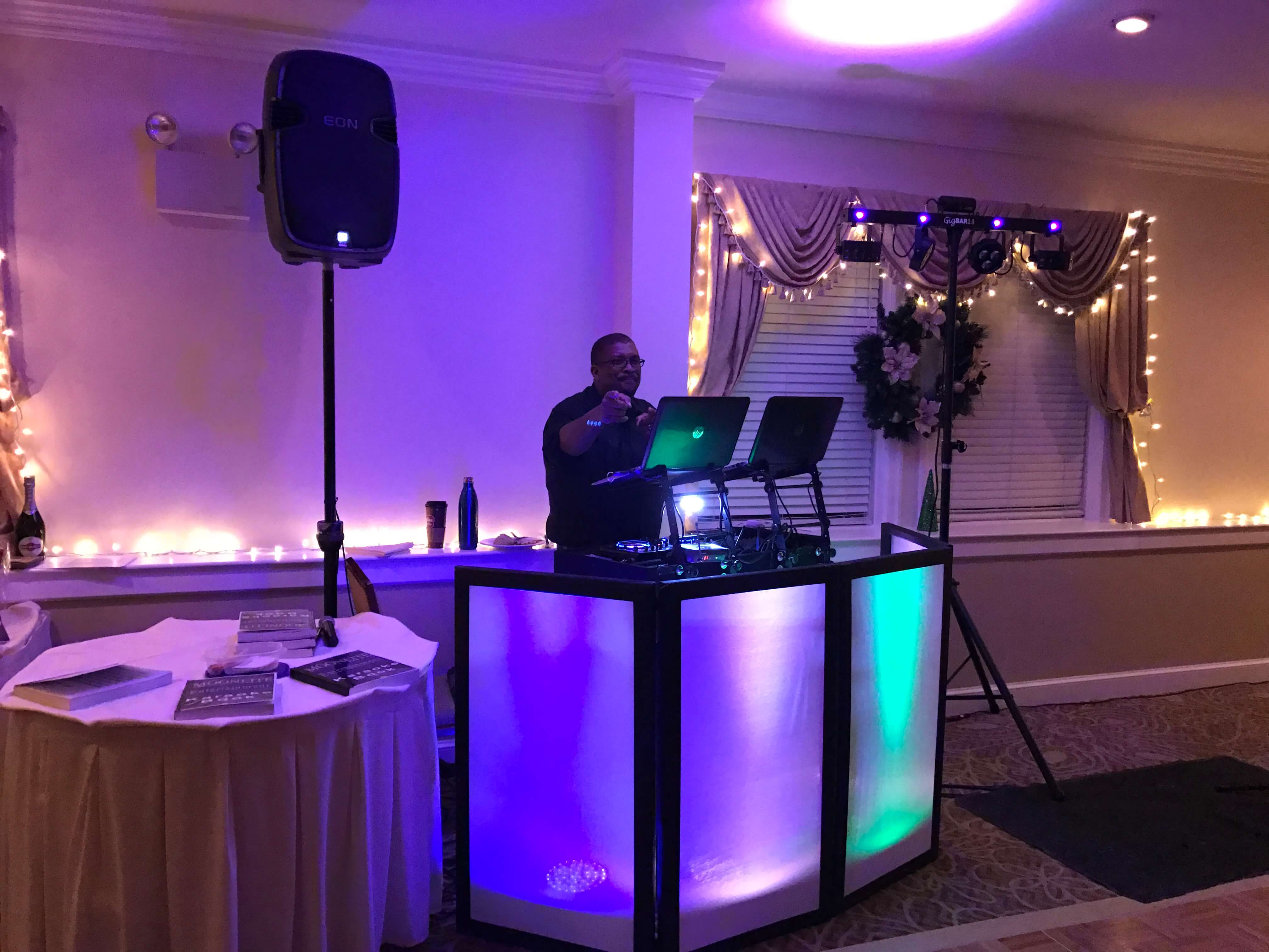 dj at booth with up lighting